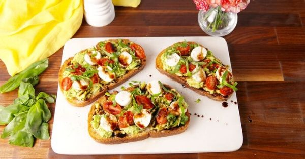 photo shows caprese avocado on toast