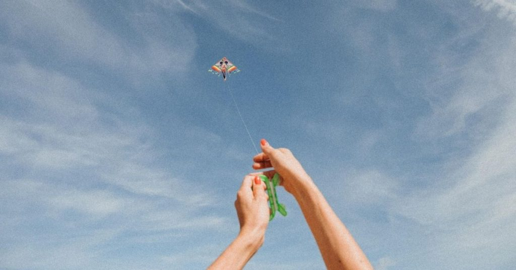 person flying a kite